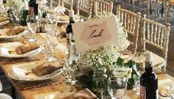Our Limewash Chiavari Chairs with cream pads at a stunning event.