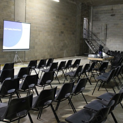 Construction Meeting - Plastic seating set up for health & safety event.