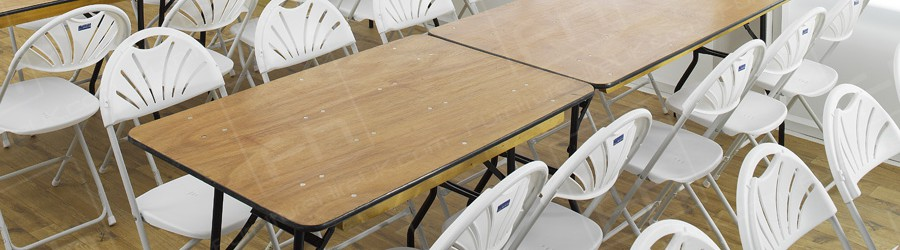 trestle tables and white folding chairs
