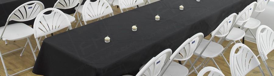 rectangular trestle tables covered